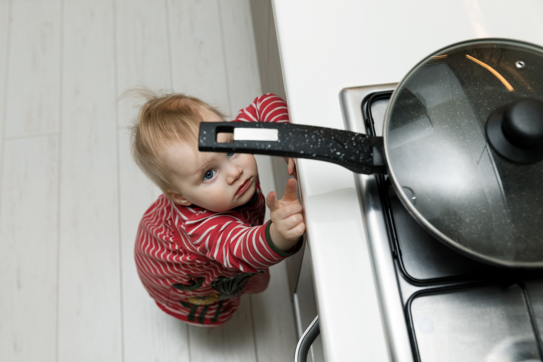 Child trying to touch the stove