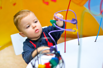 A child learning to perform motor skills