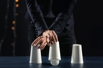 Magic cup game played by magician