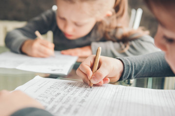 Student practicing alphabets using shorter pencils