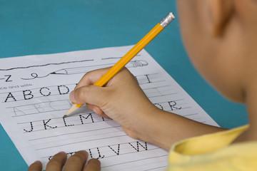 Student practicing english alphabets