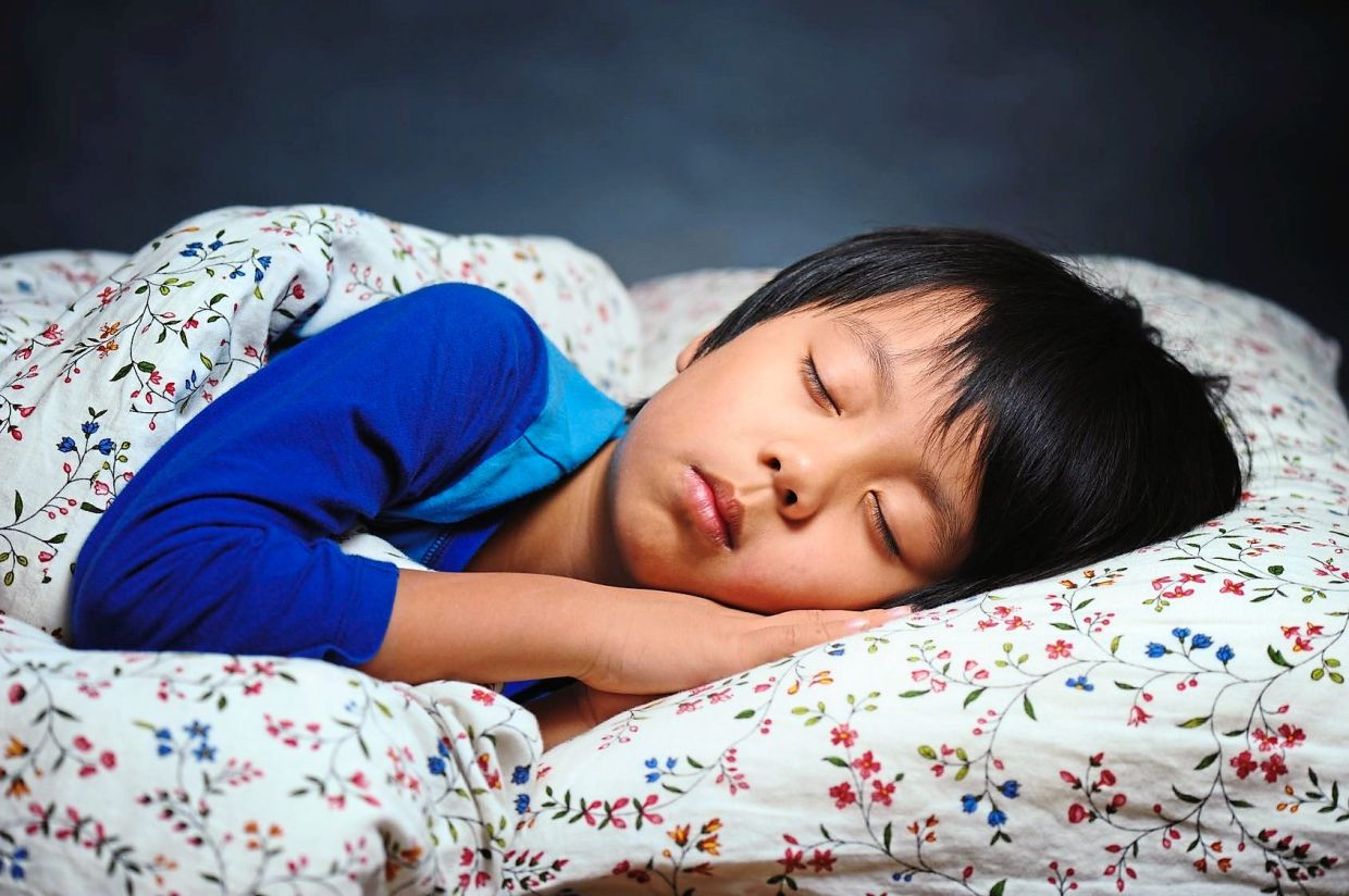a kid sleeping well at night