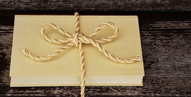 book wrapped in a fancy ribbon as a gift encourages reading in kids