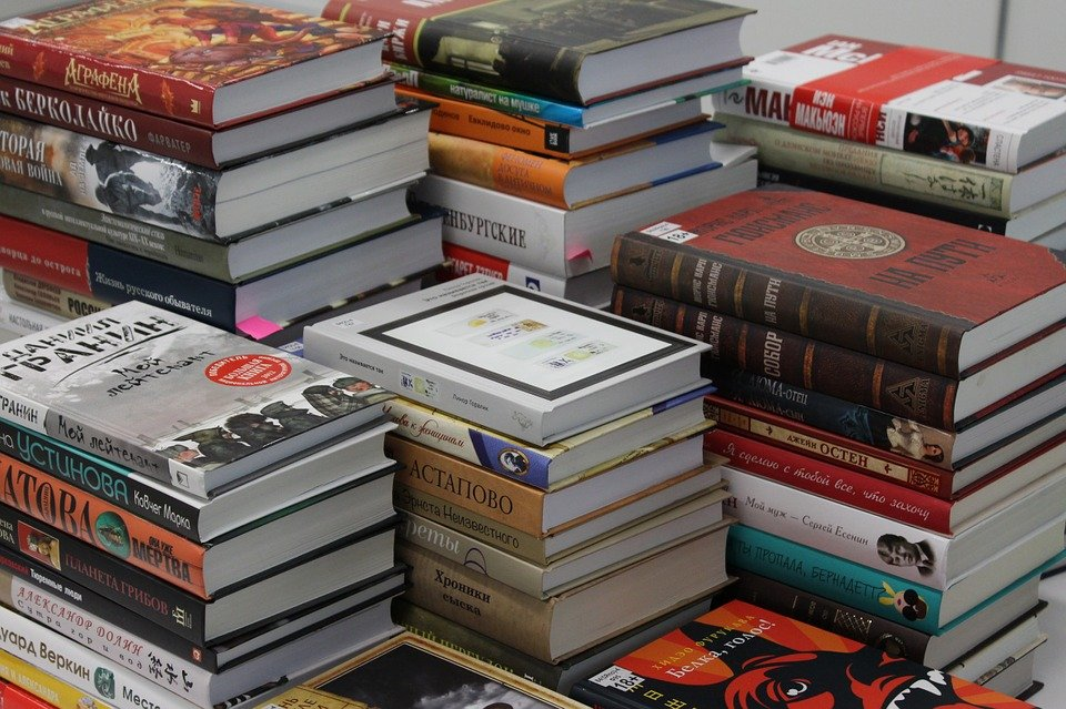 a pile of books of different varieties for a great reading habit