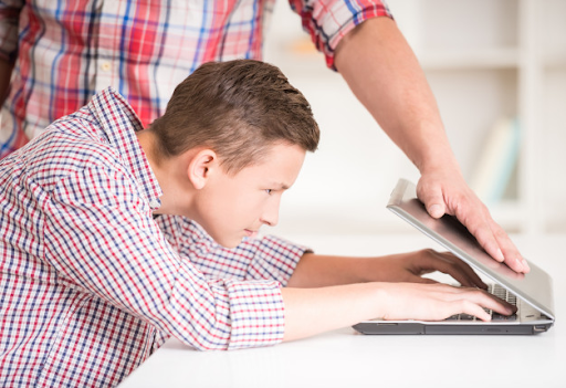 Strict parent who is closing laptop