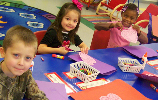 Children making paper cards on thankgiving