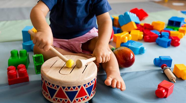 Kid playing with drums