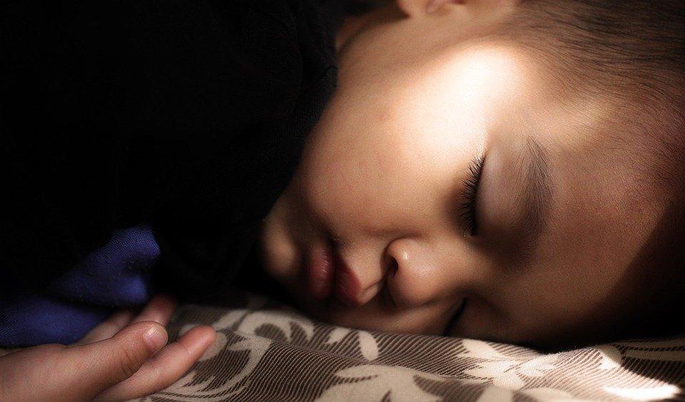 child in deep sleep in third Non-REM stage