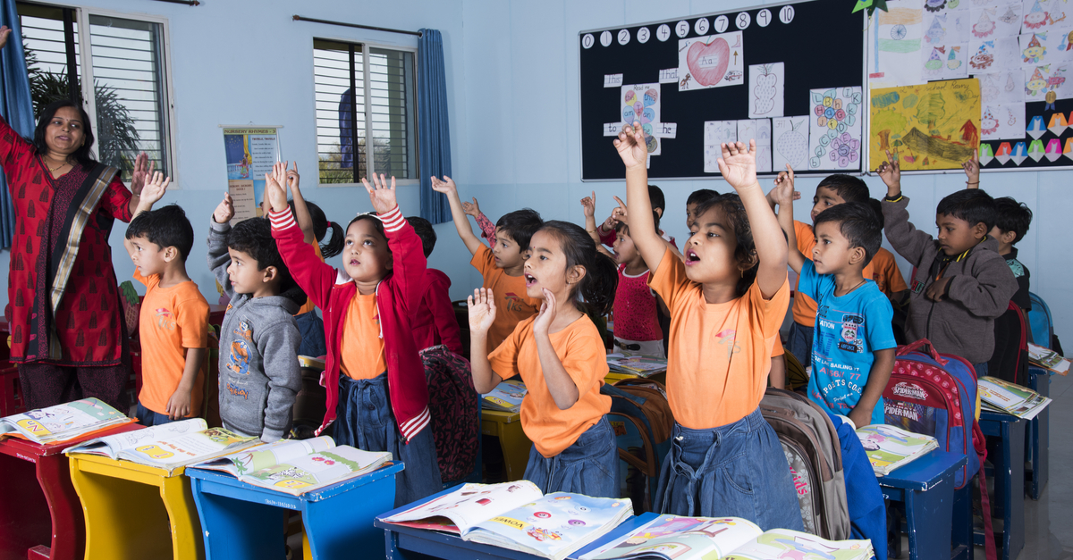 Kids singing and dancing together in classroom activity