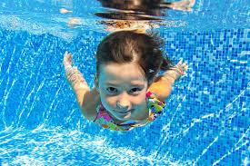 Kid diving in underwater