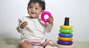 toddler holding toys