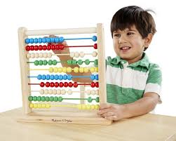 kid learning to count on abacus