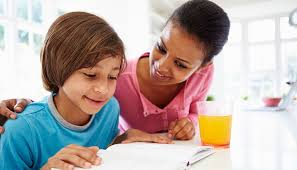 Mother helping her son out in doing homework