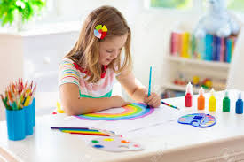A girl painting a rainbow