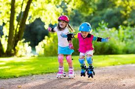 Kids roller skating on road