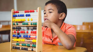 kid doing math with the help of abacus