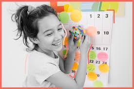 Kid making a summer calendar
