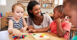 teacher happily teaching kids