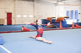 Kid performing gymnastics