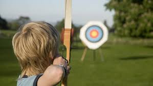 kid doing archery