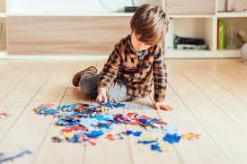 Child playing with jigsaw puzzles