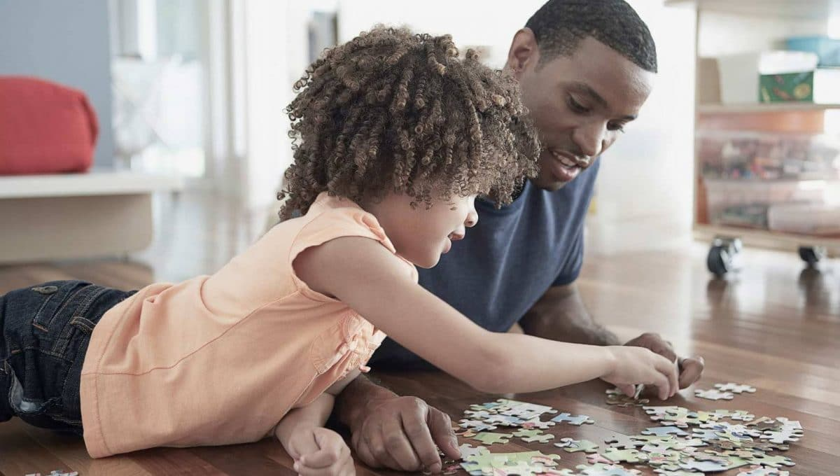 Child solving jigsaw puzzle