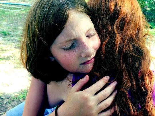 girl hugging mom