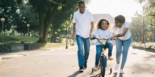 Parents taking their kid for cycling