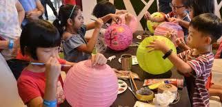 Children making paper lanterns
