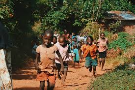 Kids running on the road in Africa
