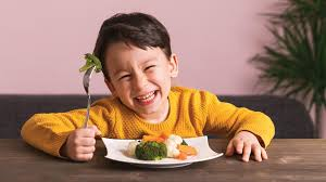 kid happily having a balanced diet