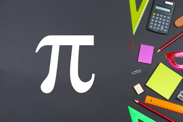 The inscription of pi day and chalk on a blackboard.