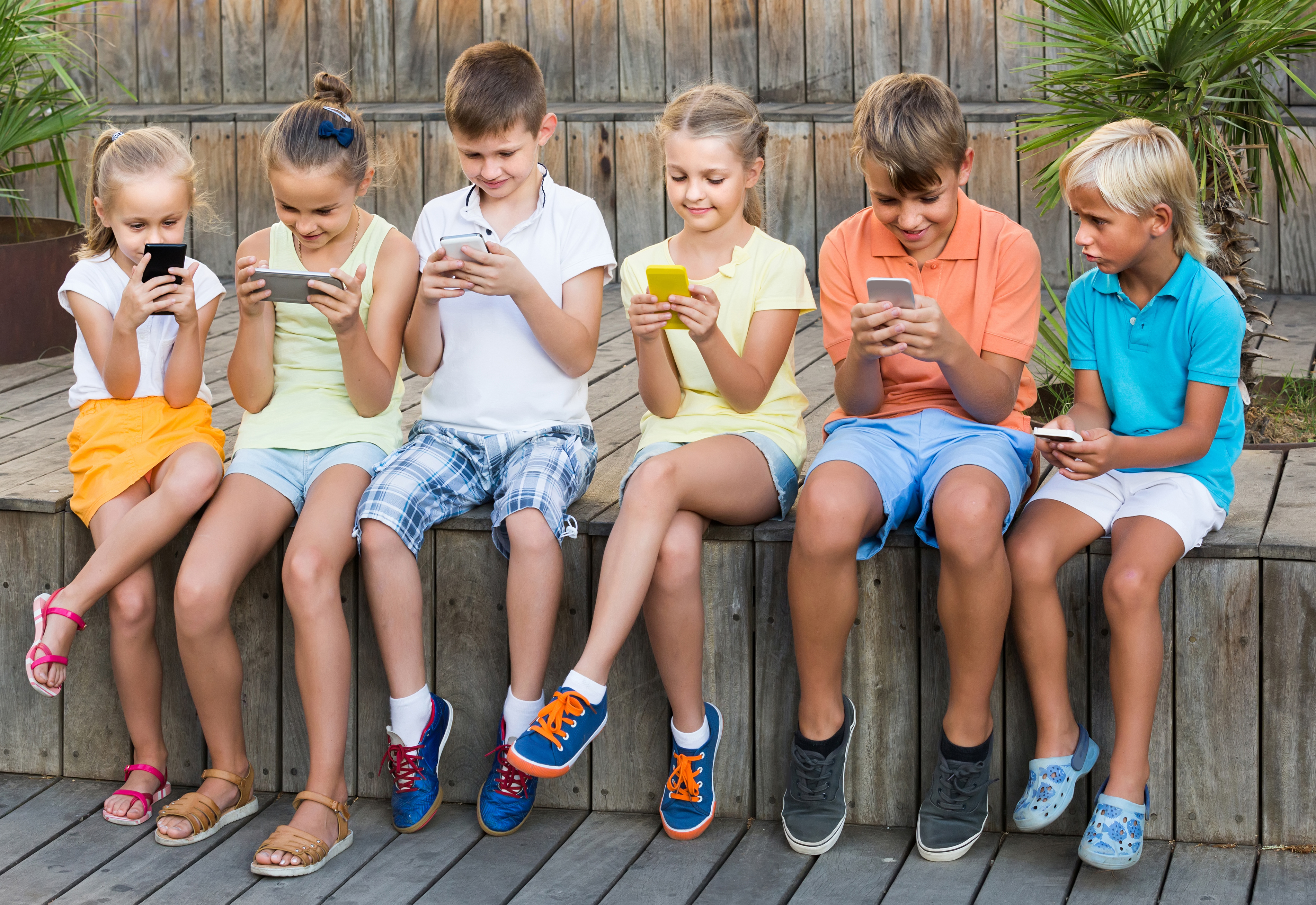 kids busy with phone