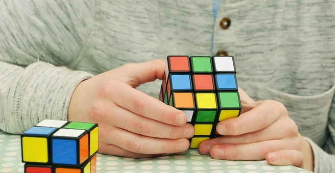 Fun activities at home: child solving Rubik's cube