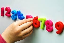 Child arranging numbers