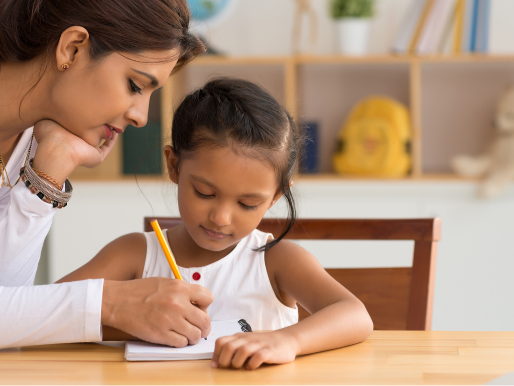 A teacher explaining a concept to her child about growth mindset