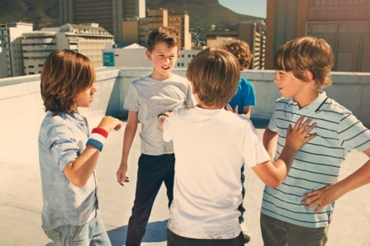 Group of boys defending themselves from quarreling.