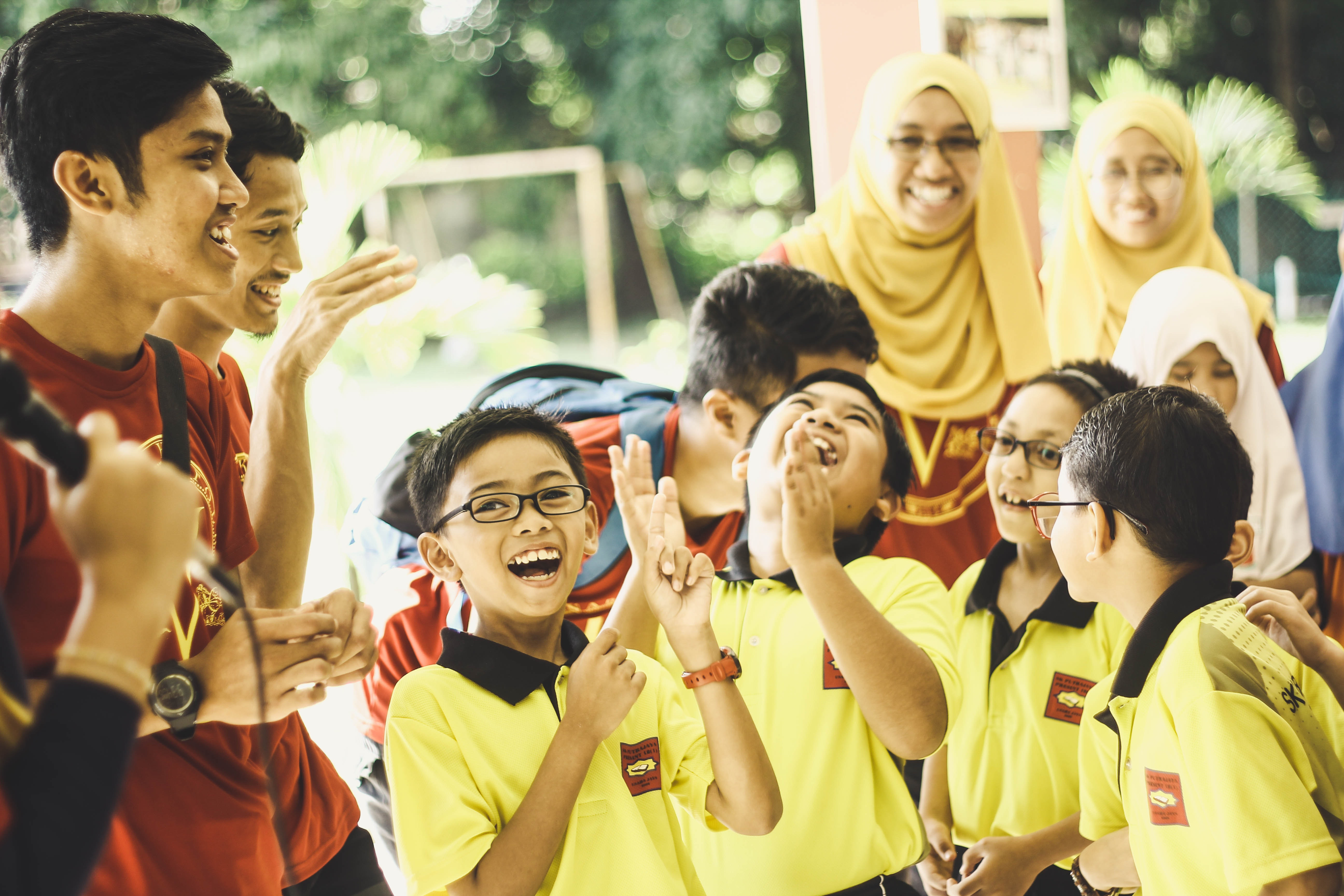Kids in yellow uniform having a happy moment