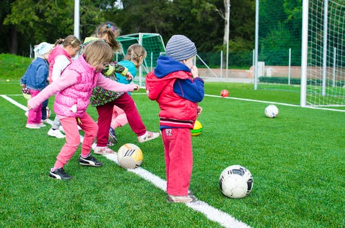 fun exercises for kids: children playing football