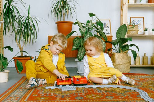 2 kids playing with interesting toys to find their passion for kids