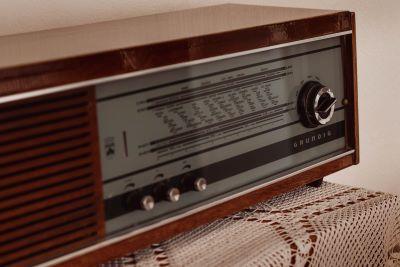 a radio: sound waves travel in sine function form
