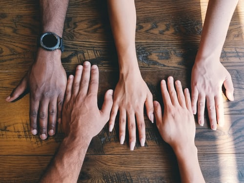 cultural relevance: hands showcasing cultural diversity in students