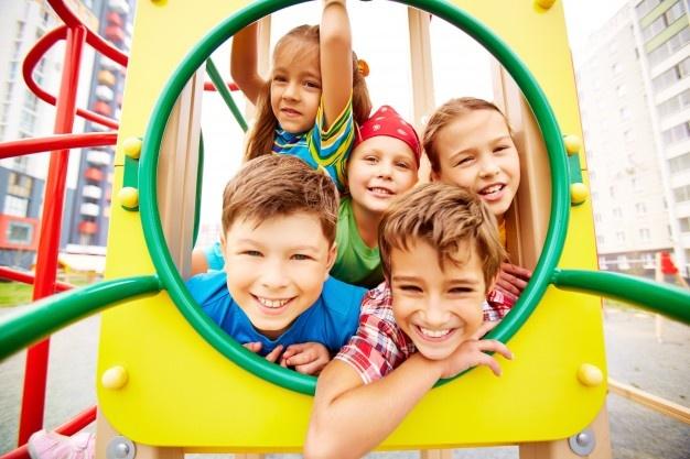 Playful classmates having fun on playground