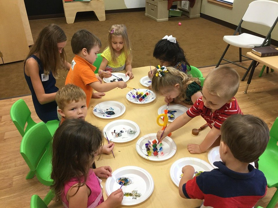 students performing fun art and craft activities in classroom