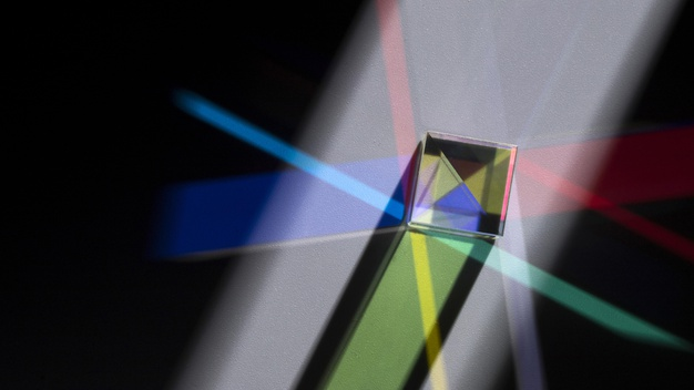 Prism refracting colourful lights in optics