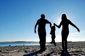 Parents with their kid on a beach