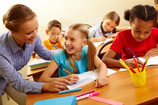 School girl having a good time with the teacher