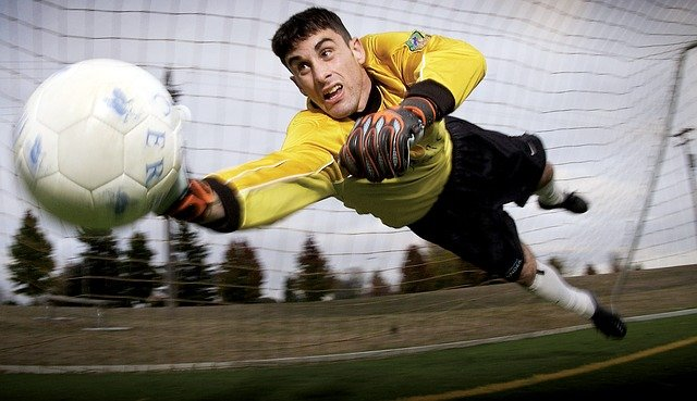 Player performing the chip shot over the goalkeeper